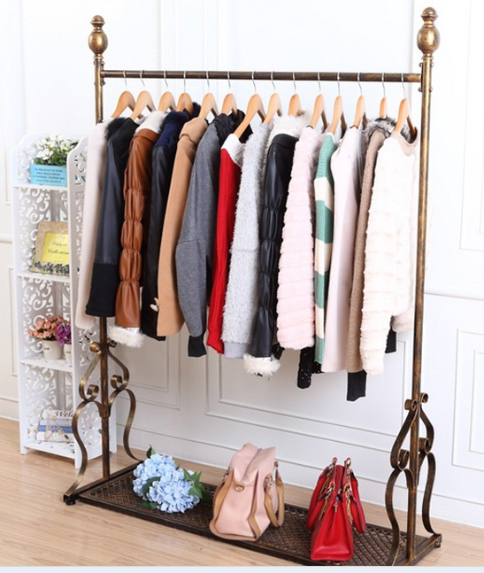 Cheap-wrought-iron-clothing-rack-clothing-store-for-clothes-hangers-island-shelf-floor-display-racks-indoors